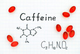 Chemical formula of Caffeine with red pills. - 176878141