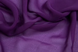 purple crumpled rayon on a white base with waves decomposed
