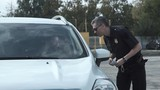 Police officer stopping the driver of a vehicle and questioning him over an alleged offence through the open window of the car - 176887118