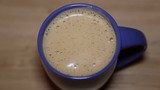 Fresh cappuccino with foam in a blue cup - 176887359