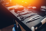 Fototapety hairdresser's tools: combs, razors, scissors, clip-on hair clipper