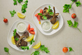 Lamb chops served with tzatziki sauce - 176892180