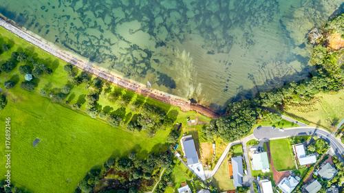 Aerial view on a farmland on the shore of sunny harbour. Whangaparoa peninsula, Auckland, New Zealand