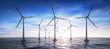 Leinwandbild Motiv Windpark im Ozean im Sonnenuntergang