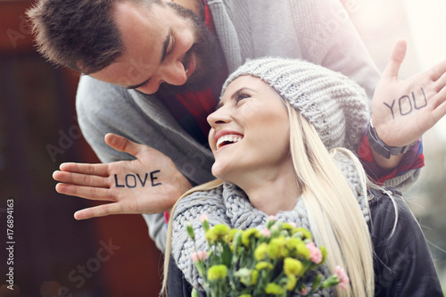 Picture showing young couple with flowers dating in the city - 176894163