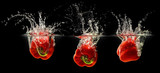 Red bell pepper falling in water