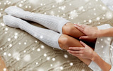 close up of woman legs in winter knee socks on bed - 176901771