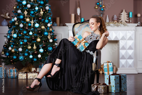 Plakát Holidays, celebration and people concept - young woman in elegant dress over chr