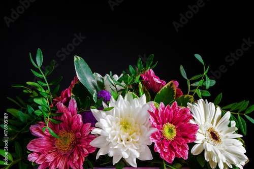 Various composition patterns and ornament flowers on a black background. Top view with copy space - 176905189