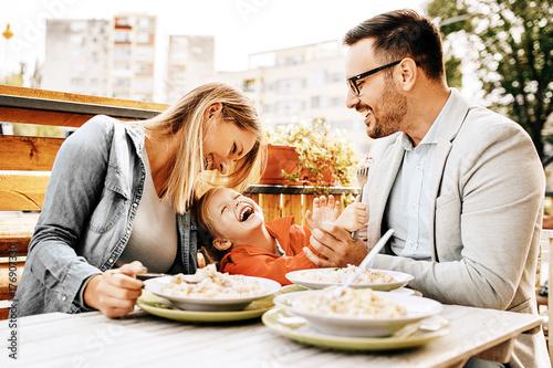 Plakát Family enjoying restaurant