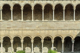 arches, columns and Romanesque capitals of the monastery of Santa Maria of Ripoll, in Catalonia, Spain. - 176907522