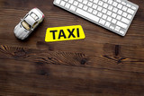 app for order a taxi online with car toy and keyboard on wooden background top view space for text - 176908742