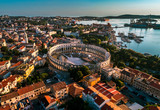Pula Arena at sunset - HDR aerial view taken by a professional drone. The Roman Amphitheater of Pula, Croatia