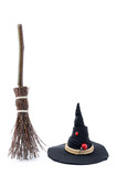 Magic Broom and Witch Hat on a White Background - 176920588