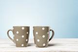 coffee mugs on wood background - 176943342