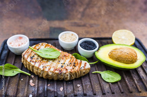 Papiers peints Steakhouse Grilled tuna steak with sesame and avocado.