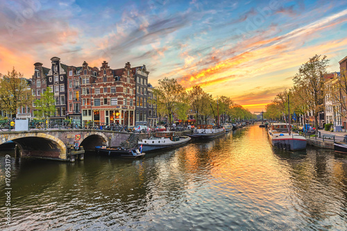 Fotobehang Amsterdam Amsterdam sunset city skyline at canal waterfront, Amsterdam, Netherlands