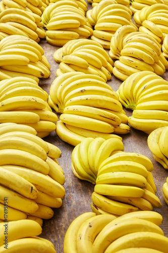 Natural ripe organic banana bunches on a local market, selective focus.
