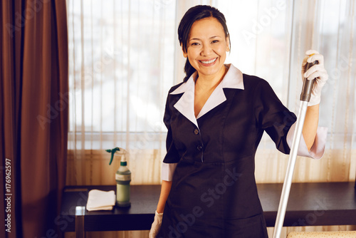 Positive delighted international maid looking forward