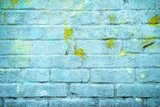 Background and wallpaper or texture of a blue brick wall with stains of yellow paint. - 176965963