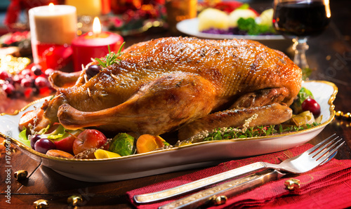 Roast Christmas duck with apples - 176966105
