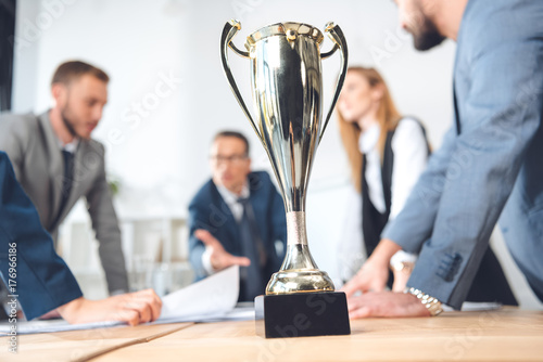Fridge magnet champion cup standing in office