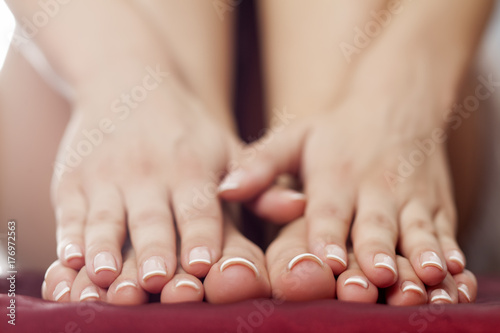 Aluminium Pedicure feminine feet and hands with nicely fixed nails