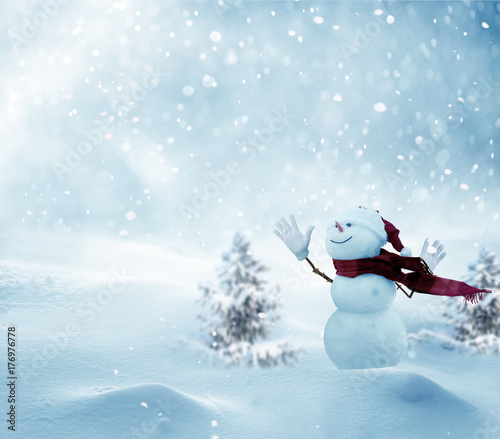 Leinwanddruck Bild Merry christmas and happy new year greeting card with copy-space.Happy snowman standing in winter christmas landscape.Snow background