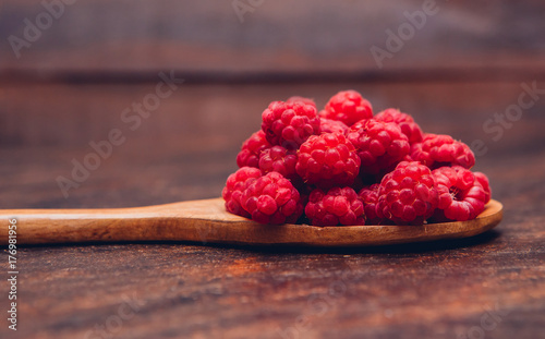 Raspberry on a brown background for use as a background or advertisement
