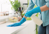 Woman cleaning with a spray detergent - 176986373