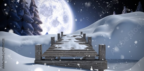 Wall mural Composite image of wooden bridge on snow covered mountain