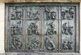 Huge metal door with plastic figures of Czech history - 176989174