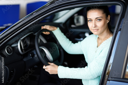 Plakat Young woman driving her car