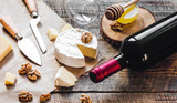 red wine with cheese and honey on wooden background - 177003366