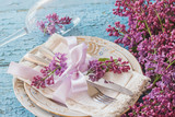 Tableware and silverware with bouquet of light violet lilac - 177010533