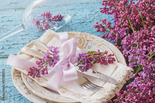 Tableware and silverware with bouquet of light violet lilac Plakat
