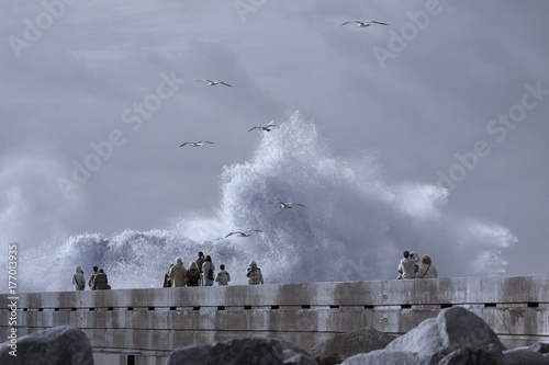 People looking at the waves splashes
