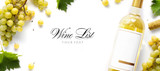wine list background; sweet white grapes and wine bottle - 177016596