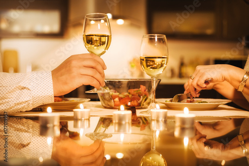 Young couple have romantic dinner with wine. Romantic concept . Plakat