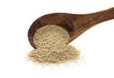 Pile white sesame seed in wooden spoon isolated on white background - 177024548