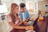 Couple having breakfast in kitchen - 177024980