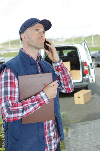 Delivery driver using telephone Poster