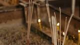 Religious yellow candles and aromasticks. Wat Saket, Bangkok, Thailand. - 177026348