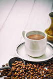Coffee cup and beans on old kitchen table. Top view with copyspace for your text - 177033572