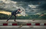 Businessman with white umbrella protecting himself from the storm.  Business heavy tasks and problems concept. - 177050383