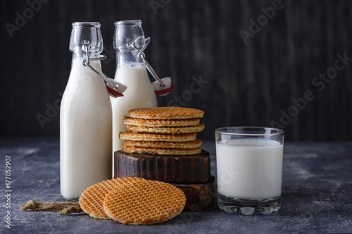 Fotobehang Milkshake Glass, two bottle of milk and cookies with jam
