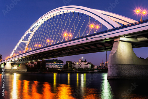 Illuminated Apollo bridge at night in Bratislava, Slovakia Poster