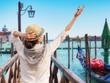 Young female traveler on pier enjoying beautiful view, Venice