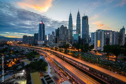 Kuala Lumpur skyline and skyscraper with highway road at night in Kuala Lumpur, Malaysia Poster