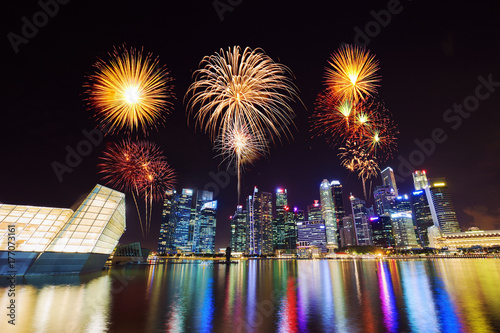 firework over central business district building of Singapore city at night Poster